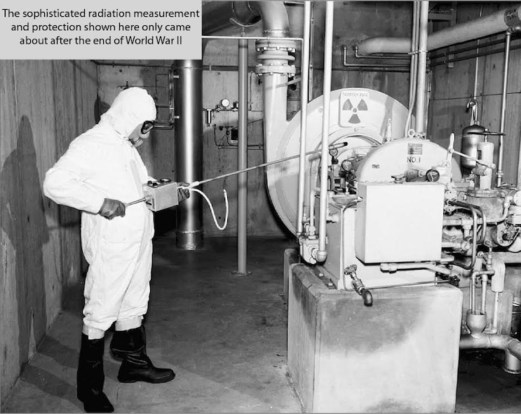 Orville F. Hill, a nuclear chemist and the grandfather of U.S. Air Force Col. Aeneas Gooding, conducts radiation measurements at a research facility in New Mexico.