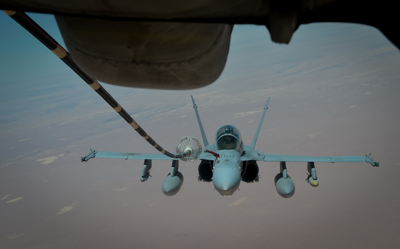 A U.S. Marine Corps F-18 Super Hornet receives fuel from a 908th Expeditionary Air Refueling Squadron KC-10 Extender during a flight in support of Operation Inherent Resolve May 31, 2017. The Super Hornet is capable across the full mission spectrum: air superiority, fighter escort, reconnaissance, aerial refueling, close air support, air defense suppression and day and night precision strike. (U.S. Air Force photo by Staff Sgt. Michael Battles)