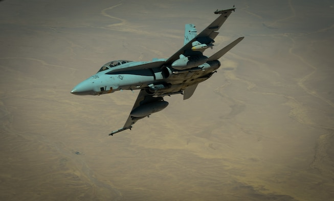 A U.S. Marine Corps F-18 Super Hornet departs after receiving fuel from a 908th Expeditionary Air Refueling Squadron KC-10 Extender during a flight in support of Operation Inherent Resolve May 31, 2017. The Super Hornet is capable across the full mission spectrum: air superiority, fighter escort, reconnaissance, aerial refueling, close air support, air defense suppression and day and night precision strike. (U.S. Air Force photo by Staff Sgt. Michael Battles)