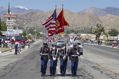 The Combat Center Color Guard leads the parade during the 67th annual Grubstake Days Parade along California Highway 62 in Yucca Valley, California.