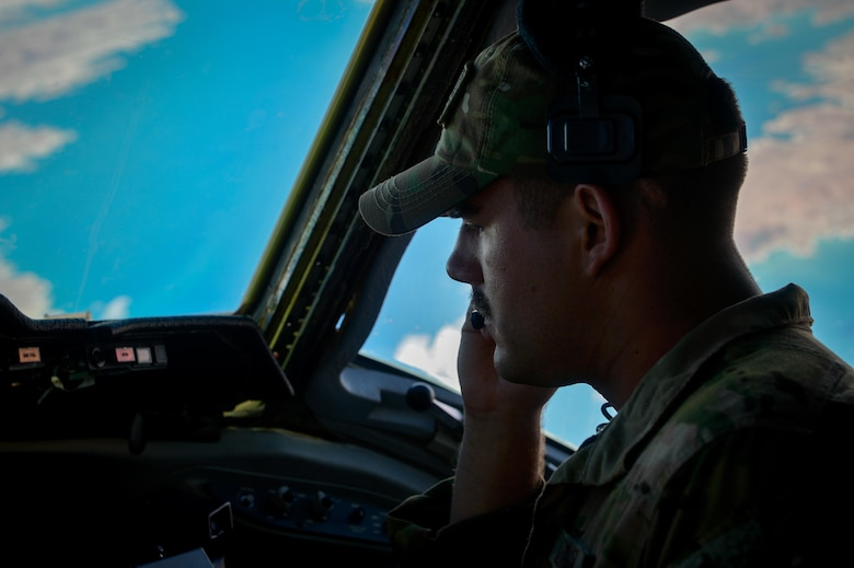 A 908th Expeditionary Air Refueling Squadron KC-10 Extender pilot speaks with the crew during a flight in support of Operation Inherent Resolve May 31, 2017. The KC-10 is an Air Mobility Command advanced tanker and cargo aircraft designed to provide increased global mobility for U.S. Armed Forces. The KC-10's primary mission is aerial refueling; it can combine the tasks of a tanker and cargo aircraft by refueling fighters and simultaneously carry the fighter support personnel and equipment on overseas deployments. (U.S. Air Force photo by Staff Sgt. Michael Battles)