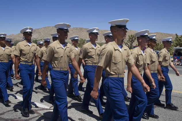 Marines with Marine Corps Communication-Electronics School march during the 67th annual Grubstake Days Parade along California Highway 62 in Yucca Valley, Calif., May 27, 2017. The town holds the annual Grubstake Days festival to embrace the mining heritage of the Yucca Valley community. (U.S. Marine Corps photo by Sgt. Connor Hancock)