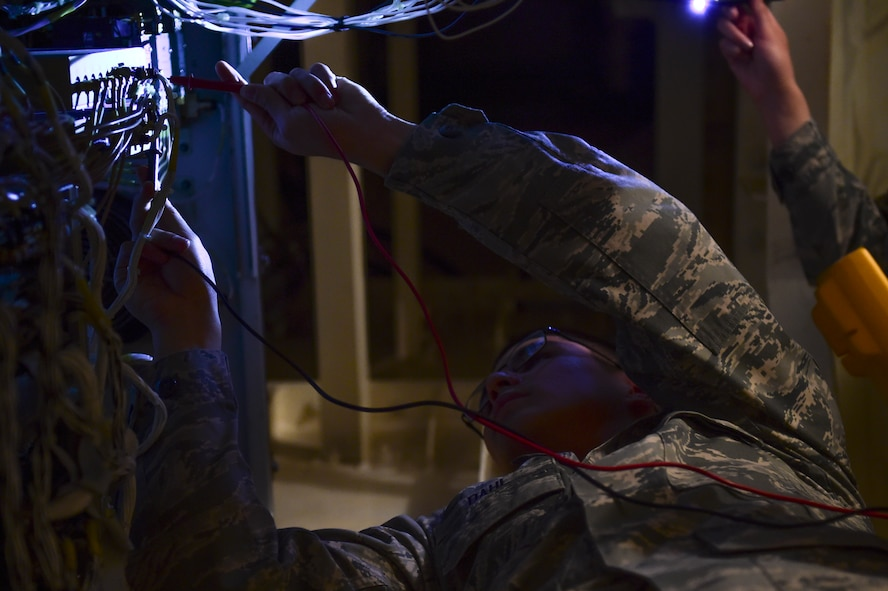 Senior Airman Eric Dahl, 460th Space Communications Squadron satellite communication technician, operates on an antenna March 15, 2017, on Buckley Air Force Base, Colo. SATCOM Airmen provide guaranteed communication, maintenance and efficiency between the satellites in space and their end-users. (U.S. Air Force photo by Airman Jacob Deatherage/Released)