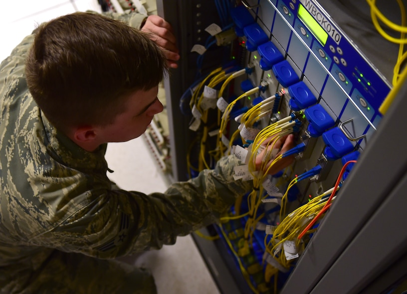 Senior Airman Clayton Traugott, 460th Space Communication Squadron circuit actions technician, operates on a circuit box March 15, 2017, on Buckley Air Force Base, Colo. Circuit actions technicians coordinate, install, maintain and troubleshoot Defense Information Systems Agency directed circuits that connects Air Force Space Command users. (U.S. Air Force photo by Airman Jacob Deatherage/Released)