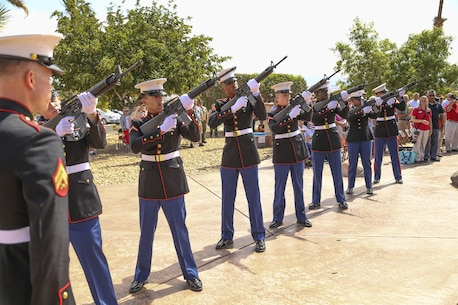 Marines from Headquarters Battalion, Marine Corps Air Ground Combat Center, Twentynine Palms, Calif., execute a rifle salute during a Memorial Day service at the Twentynine Palms cemetery, Twentynine Palms, Ca., May 30, 2017. The annual service was held to honor America's fallen servicemembers.
