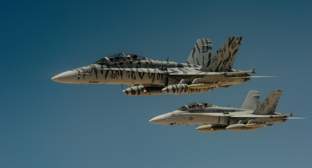 Two U.S. Marine Corps F-18 Super Hornets depart after receiving fuel from a 908th Expeditionary Air Refueling Squadron KC-10 Extender during a flight in support of Operation Inherent Resolve May 31, 2017. The Super Hornet is capable across the full mission spectrum: air superiority, fighter escort, reconnaissance, aerial refueling, close air support, air defense suppression and day and night precision strike. (U.S. Air Force photo by Staff Sgt. Michael Battles)