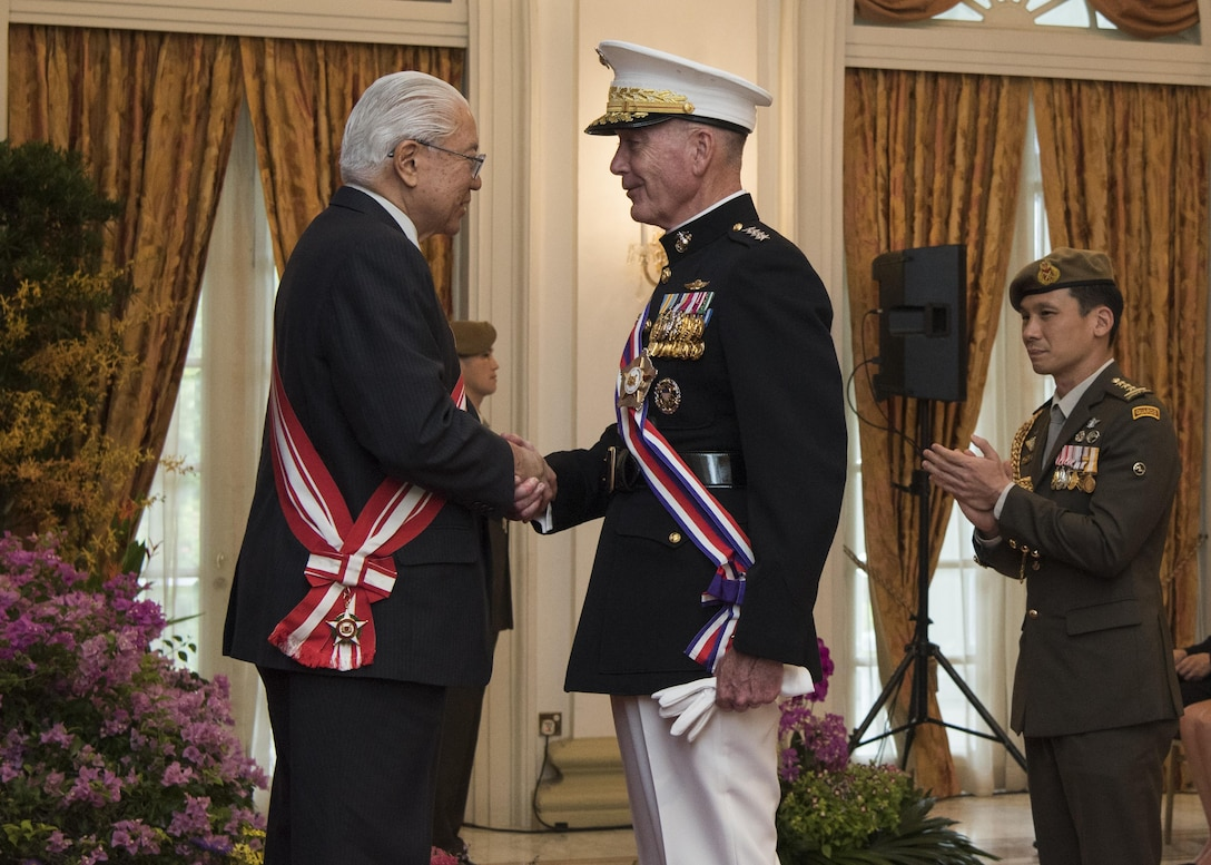 Marine Corps Gen. Joe Dunford, chairman of the Joint Chiefs of Staff, speaks with Singaporean President Tony Tan after receiving Singapore's Military Distinguished Service Order medal in Newton, Singapore, June 2, 2017. Dunford is in Singapore to attend the Shangri-La Dialogue, an Asia-focused defense summit, where he will meet with regional allies and counterparts to discuss common security issues. DoD photo by Navy Petty Officer 2nd Class Dominique A. Pineiro