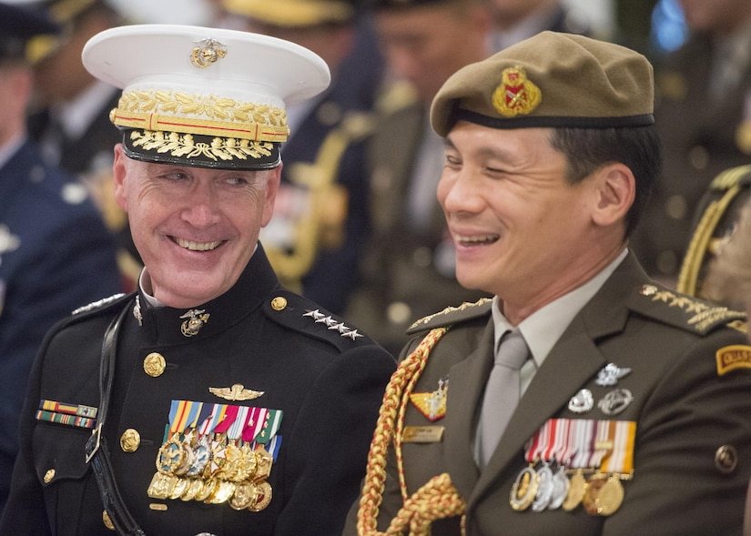 Marine Corps Gen. Joe Dunford, the chairman of the Joint Chiefs of Staff, speaks with Singaporean chief of staff, Army Lt. Gen. Perry Lim Cheng Yeow, before a medal ceremony at Singapore's presidential residence in Newton, Singapore, June 2, 2017. DoD photo by Navy Petty Officer 2nd Class Dominique A. Pineiro