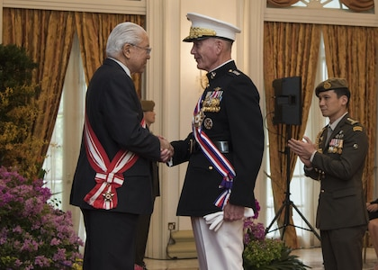 Marine Corps Gen. Joseph F. Dunford Jr., chairman of the Joint Chiefs of Staff, speaks with the President of Singapore Tony Tan after receiving an award at the Istana, June 2, 2017. Dunford is in Singapore to attend the Shangri-La Dialogue, an Asia-focused defense summit, where he will meet with regional allies and counterparts to discuss common security issues.