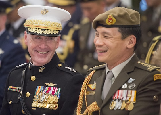 Marine Corps Gen. Joseph F. Dunford Jr., chairman of the Joint Chiefs of Staff, recieves an award from the President of Singapore Tony Tan at the Istana, June 2, 2017. Dunford is in Singapore to attend the Shangri-La Dialogue, an Asia-focused defense summit, where he will meet with regional allies and counterparts to discuss common security issues.