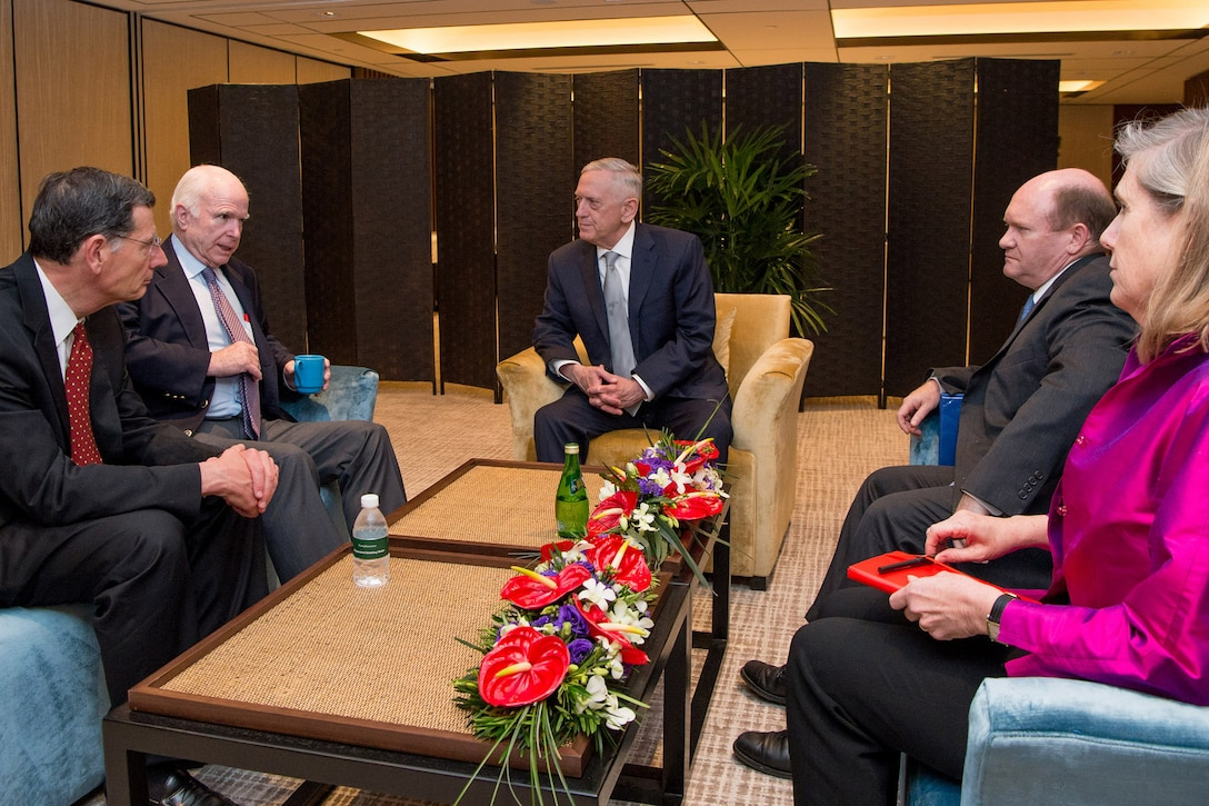 Defense Secretary Jim Mattis meets with U.S. Sen. John McCain during the Shangri-La Dialogue in Singapore, June 2, 2017. DoD photo by Air Force Staff Sgt. Jette Carr