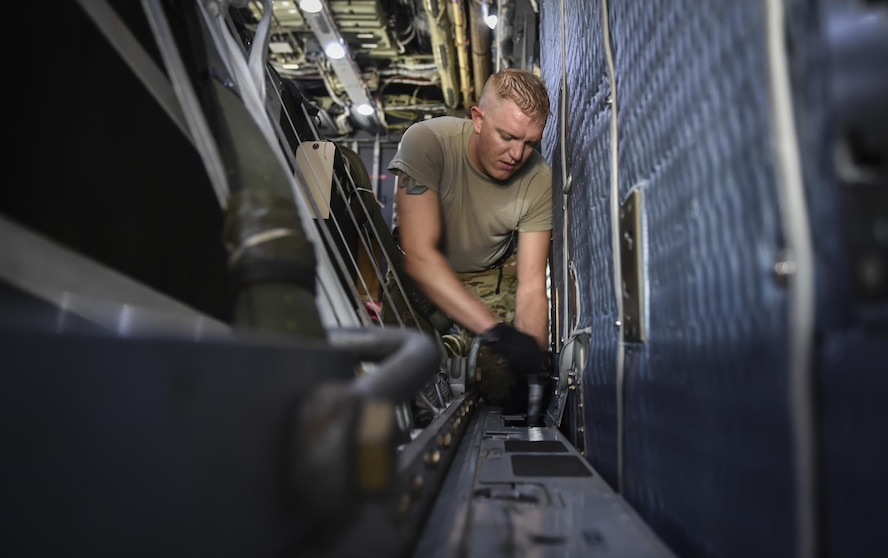 Staff Sgt. Josh Kindell, a loadmaster with the 15th Special Operations Squadron, sets the lock tension of cargo pallets on an MC-130H Combat Talon II at Hurlburt Field, Fla., May 30, 2017.The lock tension properly secures cargo until it is airdropped. (U.S. Air Force photo by Airman 1st Class Joseph Pick)