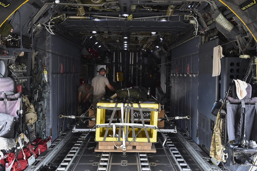 Loadmasters with the 15th Special Operations Squadron secure cargo pallets on an MC-130H Combat Talon II at Hurlburt Field, Fla., May 30, 2017. Loadmasters are responsible for properly loading, securing and escorting cargo and passengers before and during flights. (U.S. Air Force photo by Airman 1st Class Joseph Pick)