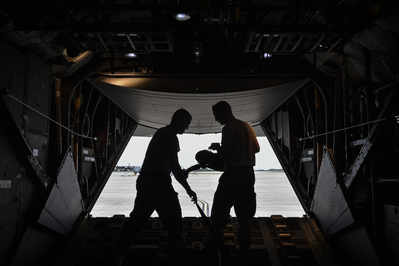 Loadmasters with the 15th Special Operations Squadron rig a heavy equipment extract parachute on an MC-130H Combat Talon II at Hurlburt Field, Fla., May 30, 2017. The purpose of this parachute is to extract heavy equipment from an aircraft in flight and assist the deployment of the load bearing parachute. (U.S. Air Force photo by Airman 1st Class Joseph Pick)