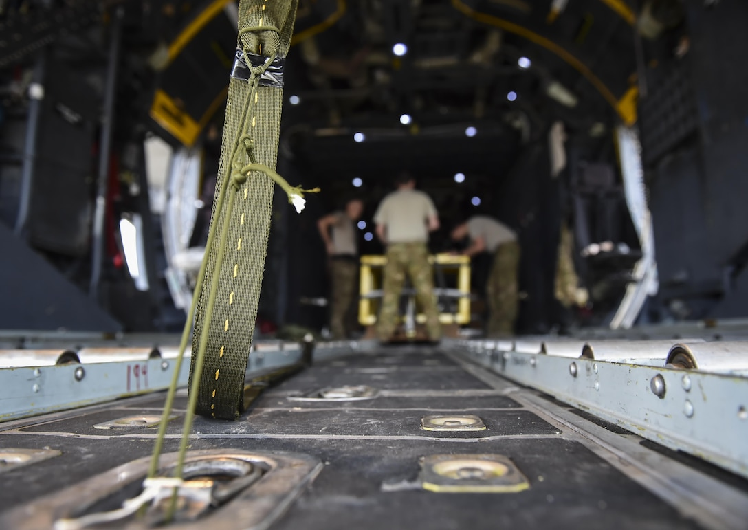 A heavy equipment extract parachute line is secured to an MC-130H Combat Talon II at Hurlburt Field, Fla., May 30, 2017. After an extract parachute is deployed, the wind force pulls cargo off the ramp of aircraft. (U.S. Air Force photo by Airman 1st Class Joseph Pick)