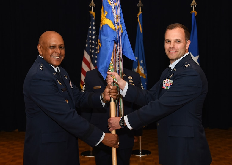 Col. David Kelley accepts the 576th Flight Test Squadron flag from Maj. Gen. Anthony Cotton, 20th Air Force commander, during a change-of-command ceremony at Vandenberg Air Force Base, Calif., June 1, 2017. In support of the 'deter and assure' mission, the 576th FLTS determines the effectiveness and accuracy of the ICBM force by planning, preparing and conducting ICBM ground and flight tests. (U.S. Air Force photo)