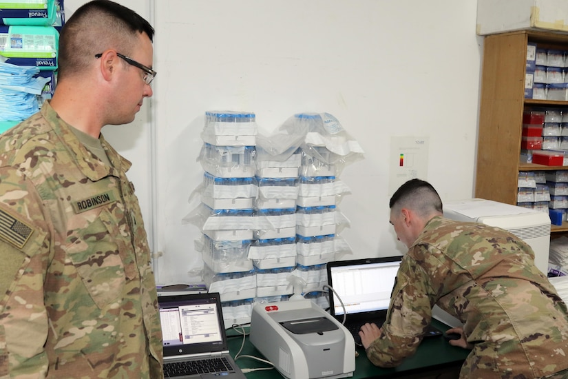 U.S. Army Sgt. Stephen Robinson (left), microbiologist noncommissioned officer, and U.S. Army Spc. Steve Bell, medical laboratory specialists, both soldiers with the 485th Preventive Medicine Detachment, inventory equipment in their office, May 26, Camp Arifjan, Kuwait. The 485th Preventive Medicine Detachment's mission is to mitigate disease and non-battle injuries for uniformed Servicemembers, U.S. Department of Defense civilians and U.S. contractors deployed in the U.S. Central Command area of responsibility.
