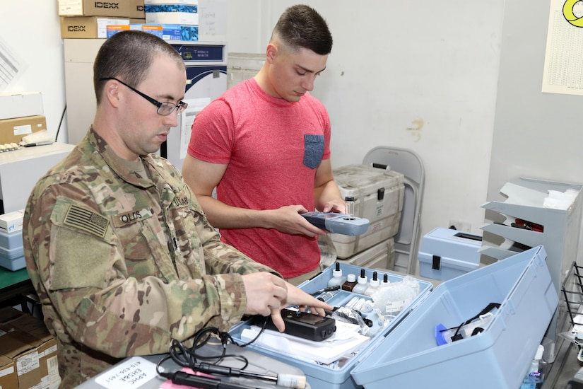 U.S. Army 1st Lt. Gregory Olds (left), executive officer, and U.S. Army Spc. Matthew Hollen, preventive medicine specialists, both soldiers with the 485th Preventive Medicine Detachment, review the functions of the Hach Kit, May 26, Camp Arifjan, Kuwait. The Hach Kit enables a person to know how the chlorine or power of hydrogen levels are in water. The 485th Preventive Medicine Detachment's mission is to mitigate disease and non-battle injuries for uniformed Servicemembers, U.S. Department of Defense civilians and U.S. contractors deployed in the U.S. Central Command area of responsibility.