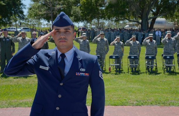 U.S. Air Force Staff Sgt. William Concepcion, a fire truck maintenance mechanic assigned to the 6th Logistics Readiness Squadron, renders a salute to the American flag during a Memorial Day ceremony at MacDill Air Force Base, Fla., May 26, 2017. Personnel and members of the community were invited to attend and pay respect to fallen heroes. (U.S. Air Force photo by Staff Sgt. Vernon L. Fowler Jr.)