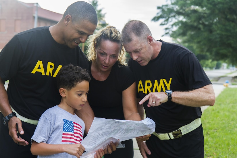 Command, his son Miles Wiggins and his wife Anke Wiggins, along with Col. Mike Vail, Chief of homeland operations at USARC, participate in an urban-orienteering event, at the USARC headquarters at Fort Bragg, N.C., June 2, 2017. The event was designed to promote individual and unit readiness by ensuring everybody stays physically fit, enhance team cohesion and improve spirit de corps. Orienteering is a competitive form of land navigation. It combines map reading, terrain study, strategy, competition and exercise. (U.S. Army Reserve photo by Sgt. Stephanie Ramirez)