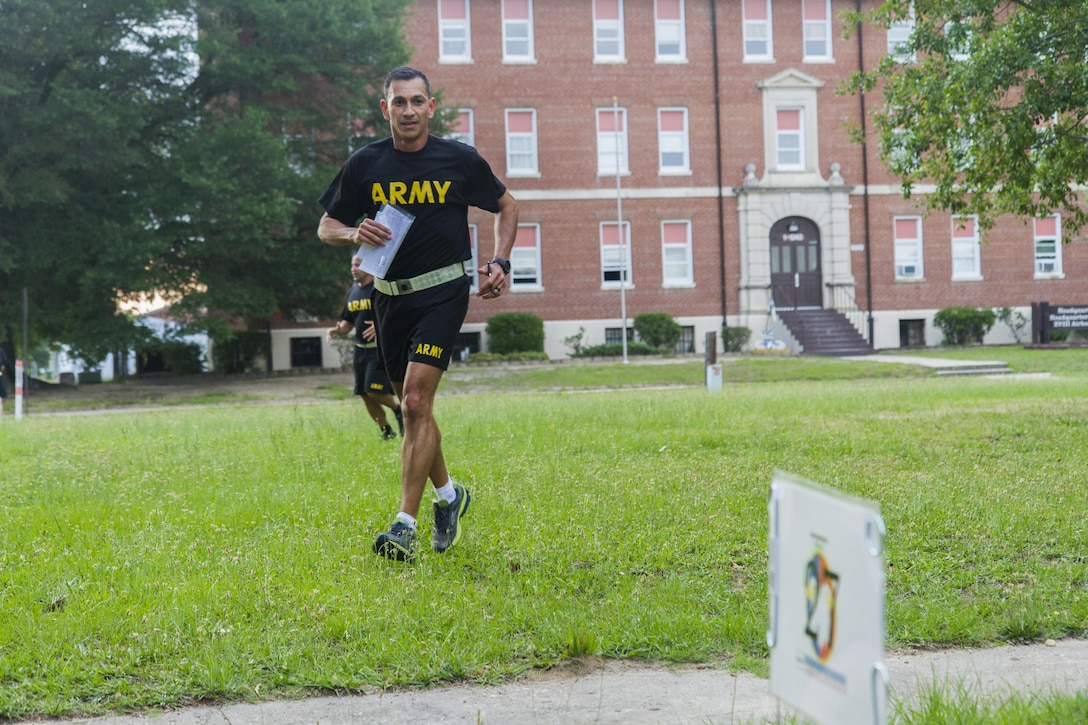 Lt. Col. Felix Torres, chief of resource management at the U.S. Army Reserve Command, runs to a land navigation point during an urban-orienteering event at Fort Bragg, N.C., June 2, 2017. The event was designed to promote individual and unit readiness by ensuring everybody stays physically fit, enhance team cohesion and improve spirit de corps. Orienteering is a competitive form of land navigation. It combines map reading, terrain study, strategy, competition and exercise. (U.S. Army Reserve photo by Sgt. Stephanie Ramirez)