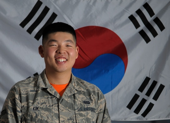 U.S. Air Force Airman 1st Class Hyo Kim, a SharePoint administrator and knowledge manager assigned to the 6th Communications Squadron pauses in front of the South Korean flag at MacDill Air Force Base, Fla., June 2, 2017. Kim is from South Korea and is a first generation U.S. service member. His sister is planning to follow in his footsteps and enlist in the Air Force. (U.S. Air Force photo by Airman 1st Class Ashley Perdue)