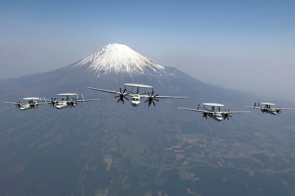 """E-2C Hawkeyes assigned to Carrier Airborne Early Warning Squadron 115 """"Liberty Bells,"""" perform a formation flight in front of Mount Fuji, May 9, 2017. VAW 115 is one of the nine squadrons assigned to the Naval Air Facility Atsugi, Japan-based Carrier Air Wing Five, which is assigned to USS Kitty Hawk (CV 63). Kitty Hawk operates out of Fleet Activities Yokosuka, Japan."""