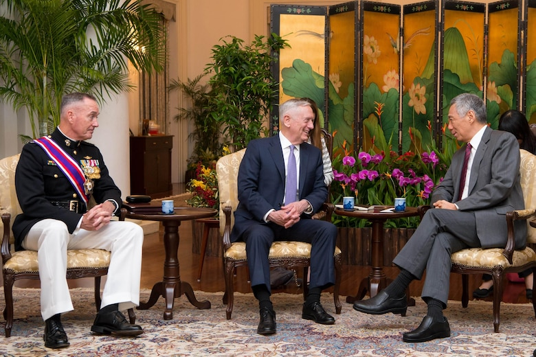 Secretary of Defense Jim Mattis and Chairman of the Joint Chiefs of Staff Gen. Joseph Dunford meet Singapore's Prime Minister Lee Hsien Loong at the Istana in Singapore on June 2, 2017.