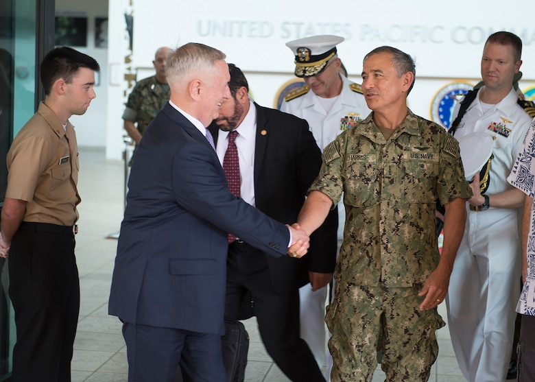 Secretary of Defense James Mattis shakes hands with Pacific Command (USPACOM) commander Adm. Harry Harris as he departs USPACOM headquarters, on the stop of an overseas trip, May 31, 2017. This is the first time Mattis has visited USPACOM headquarters since holding office as Secretary of Defense. During the meeting Mattis also met with USPACOM component commanders where they discussed challenges and opportunities in the Indo-Asia-Pacific region.