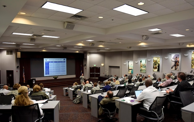 Brig. Gen. Lee Payne, AMC surgeon general, speaks to more than 30 medical group commanders, aeromedical squadron commanders and superintendents from across Air Mobility Command May 22, 2017, at Scott Air Force Base Ill. The leaders are here to learn how to improve care within their military treatment facilities.