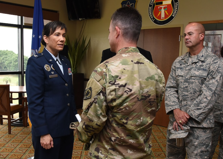 Col. Debra Lovette, 81st Training Wing commander, is greeted by U.S. Army Lt. Col. Glen Flowers, 1108th Theater Aviation Sustainment Maintenance Group commander, Mississippi Army National Guard, during a change of command ceremony reception at the Bay Breeze Event Center June 2, 2017, on Keesler Air Force Base, Miss. Lovette assumed command from Col. Michele Edmondson. (U.S. Air Force photo by Kemberly Groue)