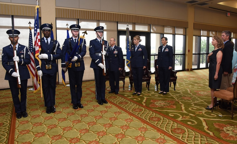 Members of the Keesler Honor Guard present the colors during the 81st Training Wing change of command ceremony at the Bay Breeze Event Center June 2, 2017, on Keesler Air Force Base, Miss. Col. Michele Edmondson passed on command of the 81st TRW to Col. Debra Lovette. (U.S. Air Force photo by Kemberly Groue)