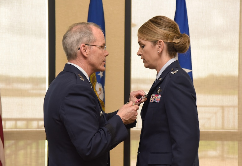 Maj. Gen. Bob LaBrutta, 2nd Air Force commander, presents the Legion of Merit medal to Col. Michele Edmondson, outgoing 81st Training Wing commander, during a change of command ceremony at the Bay Breeze Event Center June 2, 2017, on Keesler Air Force Base, Miss. The ceremony is a symbol of command being exchanged from one commander to the next by the handing-off of a ceremonial guidon. Edmondson is now assigned to be the executive officer to the vice chief of staff of the Air Force at the Pentagon in Washington D.C. (U.S. Air Force photo by Kemberly Groue)