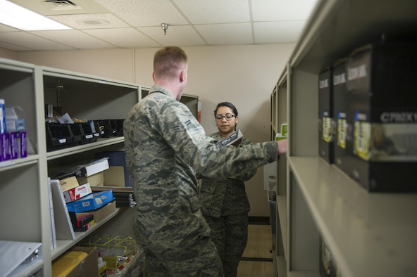 U.S. Air Force Airman 1st Class Genesis Rigg, a 354th Medical Support Squadron medical materials technician, gives supplies to Airman 1st Class Daniel Livesey a 354th Medical Operations Squadron health service journeyman June 2, 2017, at Eielson Air Force Base, Alaska. Medical material Airmen are responsible for ordering, receiving and storing different medical supplies. (U.S. Air Force photo by Airman 1st Isaac Johnson)