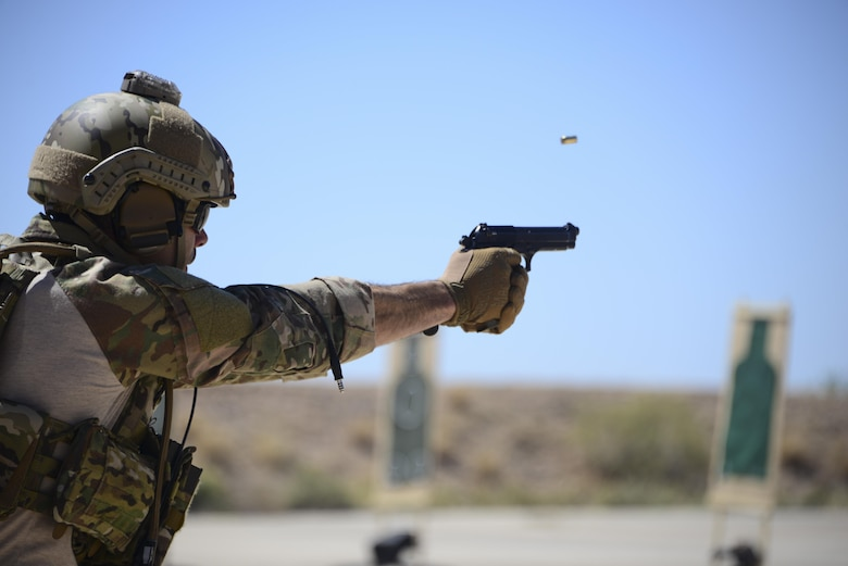 A U.S. Air Force pararescueman fires an M9 pistol at a target during the Guardian Angel Mission Qualification Training course at Davis-Monthan Air Force Base, Ariz., May 17, 2017. The MQT is a 90 day course that takes pararescuemen who have completed Air Education and Training Command schooling and helps them achieve their 5-level qualification. (U.S. Air Force photo by Airman 1st Class Nathan H. Barbour)
