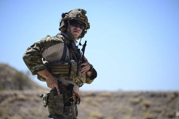 A U.S. Air Force pararescueman holsters his weapon during the Guardian Angel Mission Qualification Training course at Davis-Monthan Air Force Base, Ariz., May 17, 2017. The MQT is a 90 day GA Formal traning course that takes pararescuemen who have completed Air Education and Training Command schooling and helps them achieve their 5-level qualification. (U.S. Air Force photo by Airman 1st Class Nathan H. Barbour)