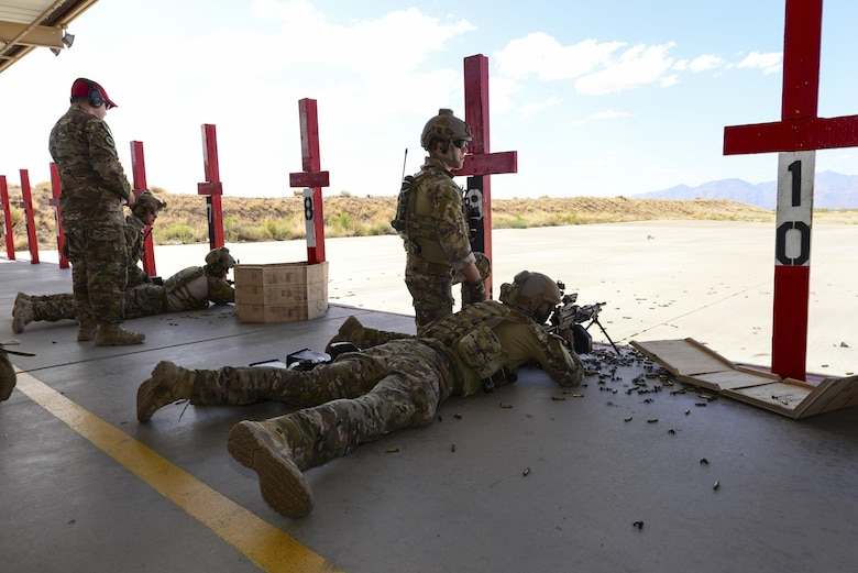 U.S. Air Force pararescuemen fire M249 automatic rifles during the Guardian Angel Mission Qualification Training course at Davis-Monthan Air Force Base, Ariz., May 18, 2017. The MQT is a 90 day course that takes pararescuemen who have completed Air Education and Training Command schooling and helps them achieve their 5-level qualification. (U.S. Air Force photo by Airman 1st Class Nathan H. Barbour)