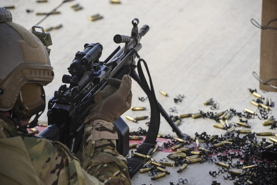 A U.S. Air Force pararescueman fires an M249 automatic rifle during the Guardian Angel Mission Qualification Training course at Davis-Monthan Air Force Base, Ariz., May 18, 2017. The MQT is a 90 day course that takes pararescuemen who have completed Air Education and Training Command schooling and helps them achieve their 5-level qualification. (U.S. Air Force photo by Airman 1st Class Nathan H. Barbour)