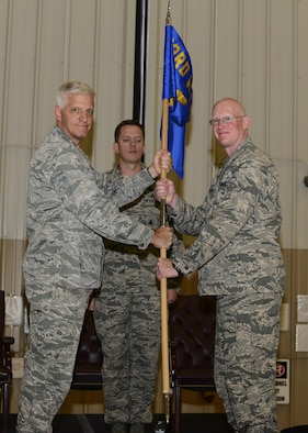 U.S. Air Force Lt. Col. Matthew McGuinness, 68th Rescue Squadron commander, receives the guidon from Col. John Lussier, 563rd Rescue Group commander, during a change of command ceremony at Davis-Monthan Air Force Base, Ariz., June 1st, 2017. Capt. Michael Ellingsen, then-68th Rescue Flight commander, relinquished command to McGuinness at the ceremony and the 68th RQF transitioned to the 68th RQS. (U.S. Air Force photo by Airman 1st Class Nathan H. Barbour)