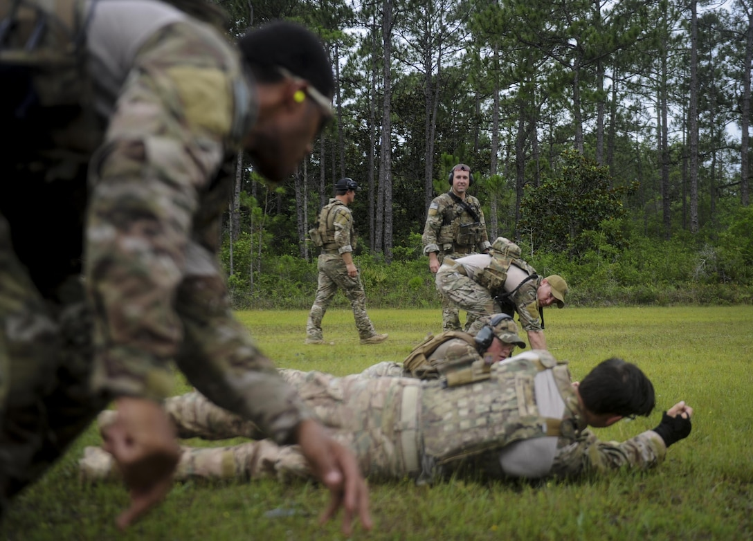 Members of the 1st Special Operations Security Forces Deployed Aircraft Ground Response Element move forward during a shoot, move, communicate drill at Hurlburt Field, Fla., June 1, 2017. The drill consisted of two teams. Shoot, move, communicate is an exercise used to train Defenders to give suppressive fire – fire that hinders an enemy from completing their mission – while under fire, avoid freezing up while in a gun fight, and continue communication with team mates. (U.S. Air Force photo by Airman 1st Class Dennis Spain)