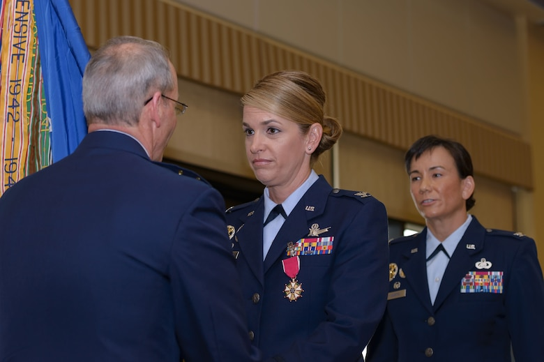 Maj. Gen. Bob LaBrutta, 2nd Air Force commander, takes the guidon from Col. Michele Edmondson, outgoing 81st Training Wing commander, during a change of command ceremony at the Bay Breeze Event Center June 2, 2017, on Keesler Air Force Base, Miss. The ceremony is a symbol of command being exchanged from one commander to the next. Edmondson is now assigned to be the executive officer to the vice chief of staff of the Air Force at the Pentagon in Washington D.C. (U.S. Air Force photo by André Askew)