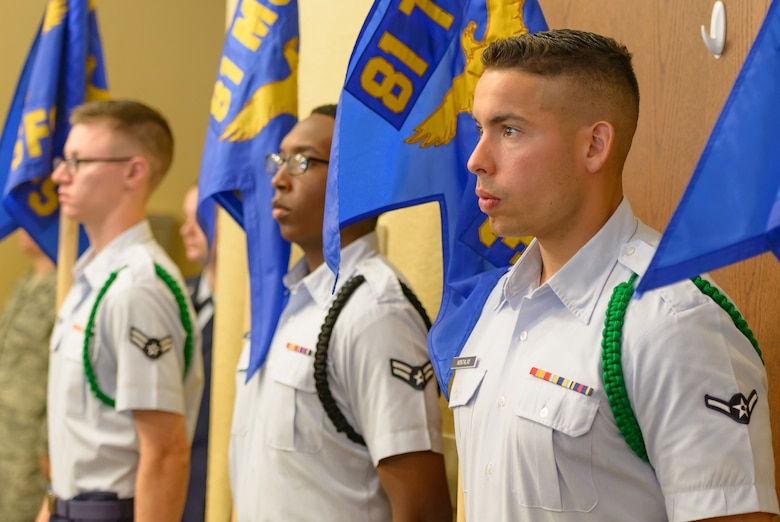 Airmen from the 81st Training Group hold Keesler squadron guidons during the 81st Training Wing change of command ceremony at the Bay Breeze Event Center June 2, 2017, on Keesler Air Force Base, Miss. The ceremony is a symbol of command being exchanged from one commander to the next by the handing-off of a ceremonial guidon. (U.S. Air Force photo by André Askew)