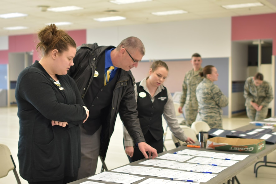 Members from the Goldrush Inn prepare to check-in TDY personnel for the upcoming RED FLAG-Alaska 17-2 exercise May 30, 2017, at Eielson Air Force Base, Alaska. The Goldrush Inn hosts hundreds of people during major exercises several times a year. (U.S. Air Force photo by Alex Bowden)