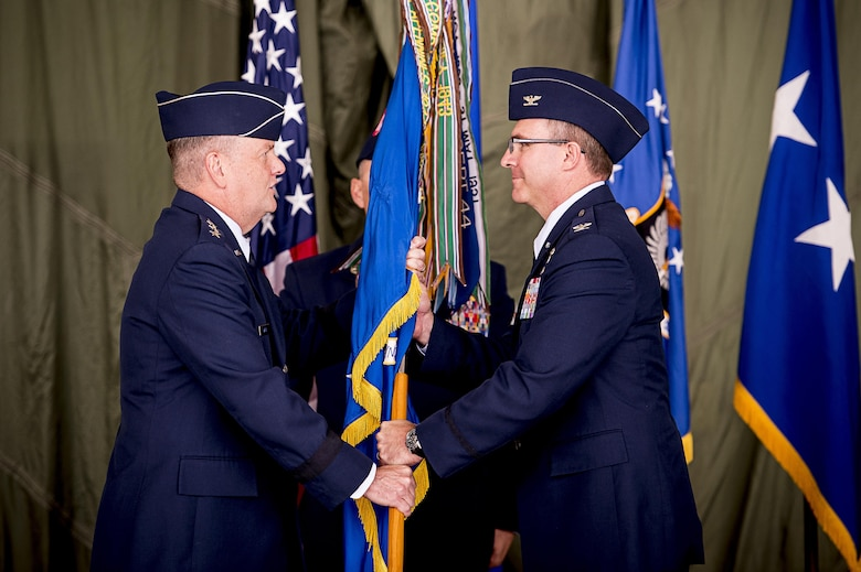 Lt. Gen. Brandon Webb, Air Force Special Operations Command commander, passes on the guidon to incoming 27th Special Operations Wing commander, Col. Stewart Hammons, during his wing's change of command ceremony at Cannon Air Force Base, N.M., Jun. 2, 2017. Col. Benjamin Maitre handed over command of the wing to Hammons. (U.S. Air Force photo by Tech. Sgt. Manuel Martinez)