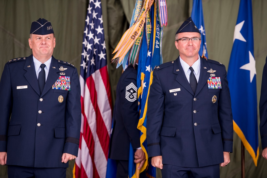 Col. Stewart Hammons, 27th Special Operations Wing commander, stands next to Lt. Gen. Brandon Webb, Air Force Special Operations Command commander, after being handed to guidon at his wing's change of command ceremony at Cannon Air Force Base, N.M., Jun. 2, 2017. Col. Benjamin Maitre handed over command to Hammons. (U.S. Air Force photo by Tech. Sgt. Manuel Martinez)