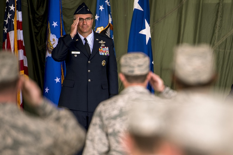 Col. Stewart Hammons, 27th Special Operations Wing commander, gives his first salute to the wing during the unit's change of command ceremony at Cannon Air Force Base, N.M., Jun. 2, 2017. Col. Benjamin Maitre relieved his command of the wing to Hammons. (U.S. Air Force photo by Tech. Sgt. Manuel Martinez)