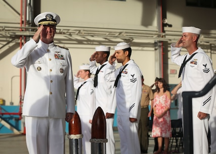 Rear Adm. Kyle Cozad, the Patrol and Reconnaissance Group Pacific commander, is welcomed on stage during Patrol Wing Squadron TWO's disbandment ceremony at Hangar 105 aboard Marine Corps Air Station Kaneohe Bay on May 24, 2017. After 80 years on Oahu, Wing TWO was disestablished and will be reassigned to Wing TEN stationed on Naval Air Station Whidbey Island, Washington. (U.S. Marine Corps photo by Cpl. Zachary Orr)
