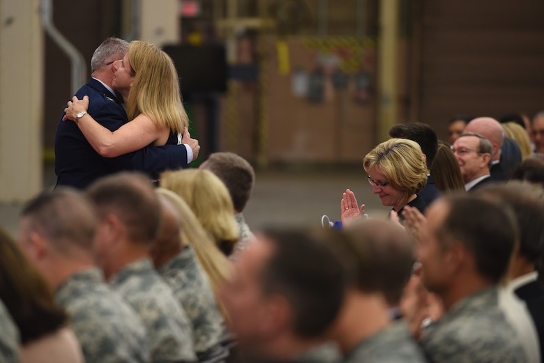 Col. J. Christopher Moss, 30th Space Wing commander, embraces his wife Brenda during his retirement ceremony, June 2, 2017, Vandenberg Air Force Base, Calif. Moss served 26 years in the Air Force, including his last two as commander of the 30th SW. (U.S. Air Force photo by Senior Airman Robert J. Volio/Released)