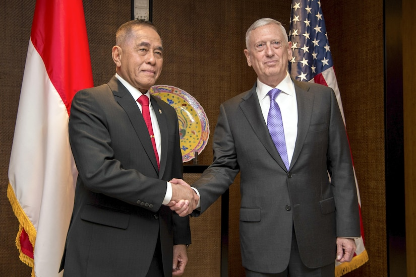 Defense Secretary Jim Mattis shakes hands with Indonesian Defense Minister Ryamizard Ryacudu during the Shangri-La Dialogue in Singapore, June 3, 2017. DoD photo by Air Force Staff Sgt. Jette Carr