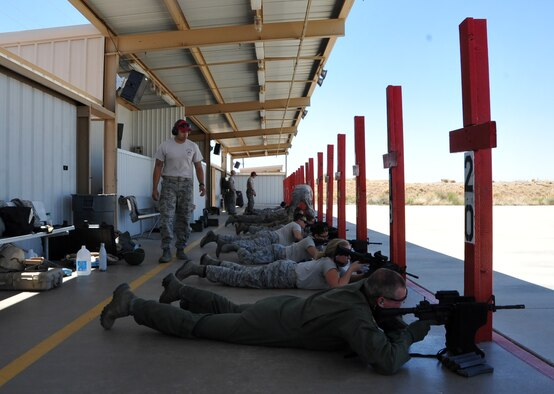 Citizen Airmen from the 943rd Rescue Group fire the M-4 rifle during a qualification shoot during the May Unit Training Assembly weekend at the Davis Monthan Air Force Base Small Arms Range on May 6, 2017 to prepare for a deployment. (U.S. Air Force Photo Master Sgt. Luke Johnson)